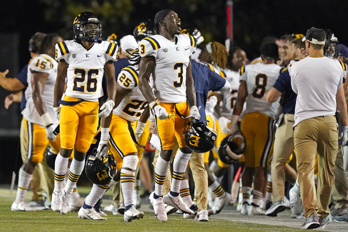 East Tennessee State's Zion Alexander (26) and Tyree Robinson (3) celebrate after beating Vanderbilt in an NCAA college football game Saturday, Sept. 4, 2021, in Nashville, Tenn. (AP Photo/Mark Humphrey)