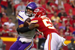 Minnesota Vikings quarterback Kirk Cousins, left, is sacked by Kansas City Chiefs linebacker Anthony Hitchens (53) during the first half of an NFL football game Friday, Aug. 27, 2021, in Kansas City, Mo. (AP Photo/Ed Zurga)