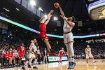 North Carolina State guard Devon Daniels (24) shoots over Georgia Tech forward James Banks III (1) in the second half of an NCAA college basketball game Saturday, Jan. 25, 2020, in Atlanta.  (AP Photo/Danny Karnik)