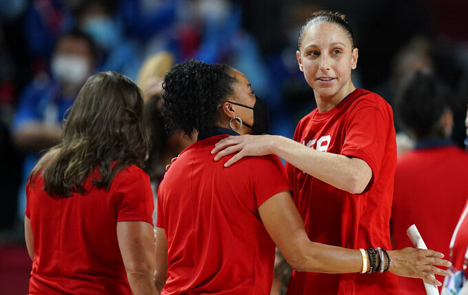 United States's Diana Taurasi, right, celebrates with head coach Dawn Staley, center, after their win in the women's basketball gold medal game against Japan at the 2020 Summer Olympics, Sunday, Aug. 8, 2021, in Saitama, Japan. (AP Photo/Charlie Neibergall)