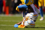 Los Angeles Chargers' Asante Samuel Jr. (26) makes in interception during the first half of an NFL football game against the Kansas City Chiefs, Sunday, Sept. 26, 2021, in Kansas City, Mo. (AP Photo/Charlie Riedel)