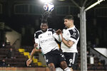 Fulham's Andre-Frank Zambo Anguissa, left, and Fulham's Aleksandar Mitrovic jump for a header during the English Premier League soccer match between Fulham and Burnley at the Craven Cottage Stadium in London, Monday, May 10, 2021. (John Walton/Pool via AP)