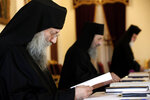 Bishops before the meeting with the head of Cyprus Orthodox Church Archbishop Chrysostomos II, who presides over, composing the Holy Synod, the Church's highest decision-making body at the Church's headquarters in the capital Nicosia, Cyprus, on Monday, Nov. 23, 2020. The Holy Synod convened to discuss issues relating to the Cyprus Church's position on the independence of the Ukrainian Orthodox Church. (AP Photo/Petros Karadjias)