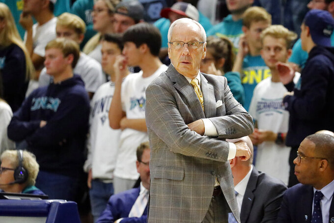 North Carolina head coach Roy Williams watches from the sideline during the second half of an NCAA college basketball game against North Carolina Wilmington in Wilmington, N.C., Friday, Nov. 8, 2019. (AP Photo/Karl B DeBlaker)