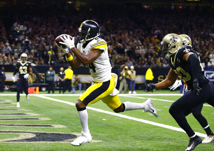 FILE - In this Dec. 23, 2018, file photo, Pittsburgh Steelers wide receiver Antonio Brown (84) pulls in a pass reception in front of New Orleans Saints cornerback Marshon Lattimore, foreground right, and strong safety Kurt Coleman in the second half of an NFL football game, in New Orleans. Antonio Brown wants out of Pittsburgh. A person with knowledge of the situation tells The Associated Press the perennial Pro Bowl wide receiver has asked the Steelers for a trade. The person spoke on the condition of anonymity because he was not permitted to publicly discuss personnel matters. Brown appeared to make his decision official in a social media post released on Instagram on Tuesday, Feb. 12, 2019. (AP Photo/Butch Dill, File)