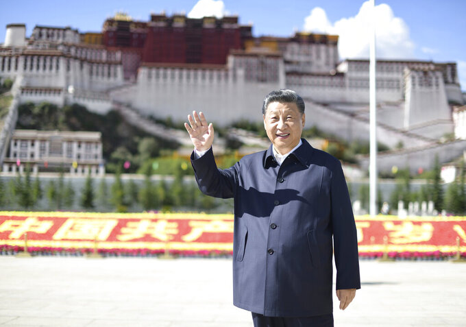 In this July 22, 2021 photo released by China's Xinhua News Agency, Chinese President Xi Jinping waves while visiting a public square below the Potala Palace in Lhasa in western China's Tibet Autonomous Region. Chinese leader Xi Jinping has made a rare visit to Tibet as authorities tighten controls over the Himalayan region's traditional Buddhist culture, accompanied by an accelerated drive for economic development. (Xie Huanchi/Xinhua via AP)