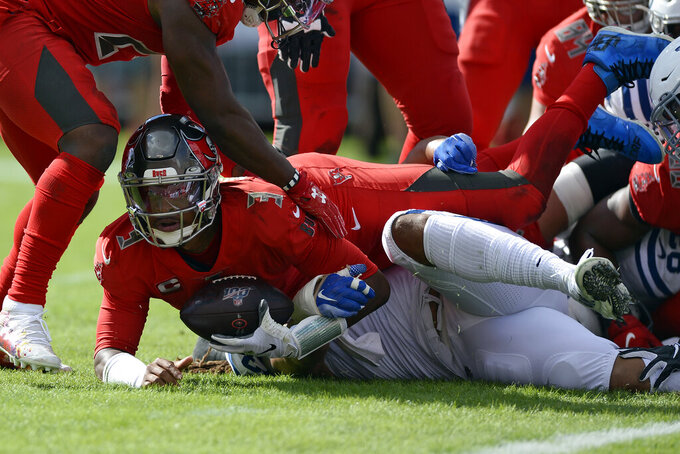 Tampa Bay Buccaneers quarterback Jameis Winston (3) scores on a 1-yard touchdown run against the Indianapolis Colts during the first half of an NFL football game Sunday, Dec. 8, 2019, in Tampa, Fla. (AP Photo/Jason Behnken)