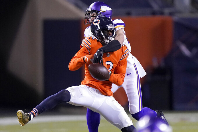 Chicago Bears wide receiver Allen Robinson II, front, has a pass broken up by Minnesota Vikings safety Harrison Smith during the second half of an NFL football game Monday, Nov. 16, 2020, in Chicago. (AP Photo/Nam Y. Huh)