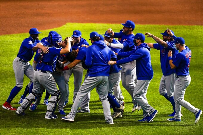 Chicago Cubs starting pitcher Alec Mills is swarmed by teammates after throwing a no hitter at a baseball game against the Milwaukee Brewers Sunday, Sept. 13, 2020, in Milwaukee. The Cubs won 12-0. (AP Photo/Morry Gash)