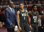 Washington State coach Ernie Kent, left, stands next to guards Jervae Robinson (1) and Ahmed Ali (23) during the first half of the team's NCAA college basketball game against Stanford on Thursday, Feb. 28, 2019, in Stanford, Calif. (AP Photo/Jeff Chiu)