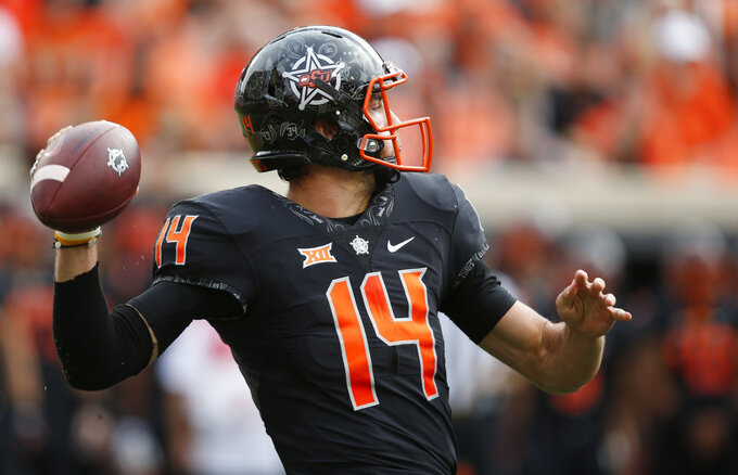 Oklahoma State quarterback Taylor Cornelius throws in the first half of an NCAA college football game against Iowa State in Stillwater, Okla., Saturday, Oct. 6, 2018. (AP Photo/Sue Ogrocki)