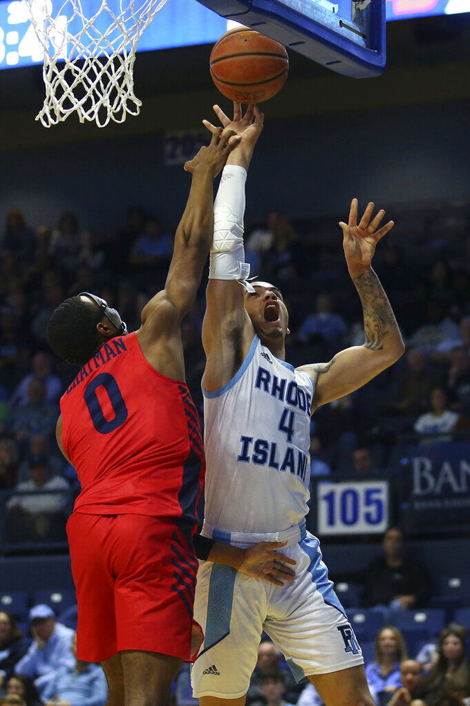 Rhode Island's Tyrese Martin (4) is fouled by Dayton's Rodney Chatman (0) during the second half of an NCAA college basketball game Wednesday, March 4, 2020, in Kingston, R.I. (AP Photo/Stew Milne)