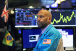 Stock trader Meric Greenbaum monitors stocks prior to the open of trading at the New York Stock Exchange, Wednesday, Sept. 18, 2019. The Federal Reserve is expected to announce its benchmark interest rate later in the day. (AP Photo/Mark Lennihan)