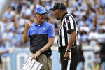 Duke head coach David Cutcliffe, left, speaks with an official during the first half of an NCAA college football game against North Carolina in Chapel Hill, N.C., Saturday, Oct. 26, 2019. (AP Photo/Gerry Broome)