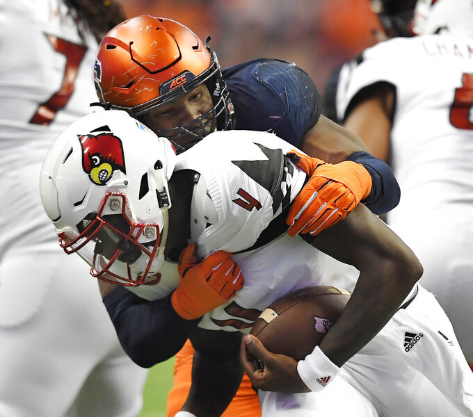 FILE - In this Nov. 9, 2018, file photo, Syracuse defensive lineman Alton Robinson, top, sacks Louisville quarterback Jawon Pass during the second half of an NCAA college football game, in Syracuse, N.Y. Robinson, Florida State's Brian Burns and Boston College's Wyatt Ray are tied for eighth in sacks with nine each. (AP Photo/Adrian Kraus, File)
