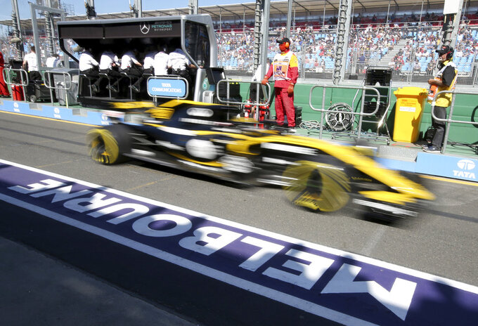 FILE - In this file photo dated, Friday, March 23, 2018, a Renault car drives down pit lane during the first practice session at the Australian Formula One Grand Prix in Melbourne.  Formula One's 21-race calendar for the 2019 season has been approved by the governing body FIA, with Melbourne as usual hosting the season-opening Australian Grand Prix at Albert Park on upcoming March 17, 2019. (AP Photo/Rick Rycroft, FILE)