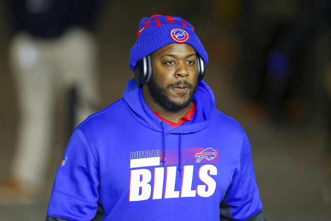 FILE - In this Dec. 28, 2020, file photo, Buffalo Bills defensive tackle Quinton Jefferson (90) watches prior to an NFL football game against the New England Patriots in Foxborough, Mass. The Bills released receiver John Brown and defensive lineman Quinton Jefferson in moves made Wednesday, March 10, 2021, to free up much-needed space under the newly announced salary cap. (AP Photo/Stew Milne, File)
