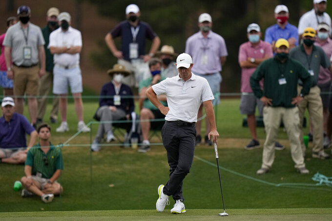 Rory McIlroy, of Northern Ireland waits to putt on the 18th green during the second round of the Masters golf tournament on Friday, April 9, 2021, in Augusta, Ga. (AP Photo/Matt Slocum)