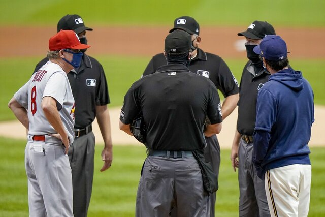 St. Louis Cardinals manager Mike Shildt and Milwaukee Brewers manager Craig Counsell talk to the umpires before the first game of a baseball doubleheader against the Milwaukee Brewers Wednesday, Sept. 16, 2020, in Milwaukee. (AP Photo/Morry Gash)