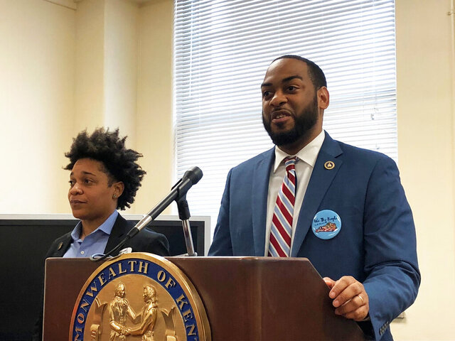 Kentucky state Rep. Charles Booker, right, promotes a voting-rights measure on Wednesday, Jan. 29, 2020, in Frankfort, Ky. Booker is the lead sponsor of a proposed constitutional amendment that would automatically restore voting rights for felons who have completed their sentences. (AP Photo/Bruce Schreiner)