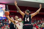 Redford Carlik Jones (1) drives to basket between Gardner Webb defenders Jose Perez (5) and Brandon Miller (14) during the first half of the Big South conference NCAA basketball championship game in Radford, Va., Sunday, March 10, 2019. (AP Photo/Lee Luther Jr.)
