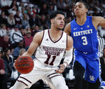 FILE - In this Saturday, Feb. 9, 2019 file photo, Mississippi State guard Quinndary Weatherspoon (11) tries to drive against the defense of Kentucky guard Keldon Johnson (3) in the first half of an NCAA basketball game against Mississippi State in Starkville, Miss.  Tennessee forward Grant Williams is the Associated Press' Southeastern Conference player of the year and Mississippi's Kermit Davis is coach of the year. Williams earned unanimous first-team all-SEC honors for a second straight season. The 14-member media panel also voted Arkansas' Daniel Gafford, Kentucky's PJ Washington, LSU's Tremont Waters and Mississippi State's Quinndary Weatherspoon to the first team.(AP Photo/Rogelio V. Solis, File)