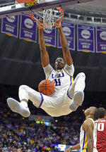 LSU forward Kavell Bigby-Williams (11) dunks as LSU guard Ja'vonte Smart, right, watches in the first half of an NCAA college basketball game against Arkansas on Saturday, Feb. 2, 2019, in Baton Rouge, La. (AP Photo/Bill Feig)