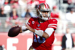 San Francisco 49ers quarterback Jimmy Garoppolo (10) looks to pass against the Atlanta Falcons during the first half of an NFL football game in Santa Clara, Calif., Sunday, Dec. 15, 2019. (AP Photo/Josie Lepe)