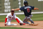 Boston Red Sox second baseman Dustin Pedroia (15) prepares to tag out Atlanta Braves' Charlie Culberson (8) on a steal attempt at second base in the fourth inning of a spring training baseball game Saturday, March 16, 2019, in Fort Myers, Fla. (AP Photo/John Bazemore)