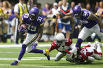 Minnesota Vikings running back Dalvin Cook (33) runs from Arizona Cardinals defenders Tramaine Brock (20) and D.J. Swearinger (36) during an 85-yard touchdown run in the first half of an NFL preseason football game, Saturday, Aug. 24, 2019, in Minneapolis. (AP Photo/Jim Mone)