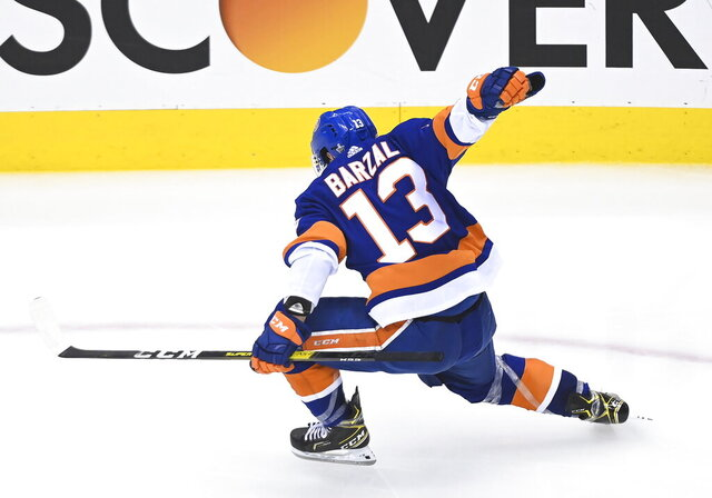 New York Islanders center Mathew Barzal (13) reacts after scoring the winning goal against the Washington Capitals during overtime NHL Eastern Conference Stanley Cup playoff hockey action in Toronto, Sunday, Aug. 16, 2020. (Nathan Denette/The Canadian Press via AP)
