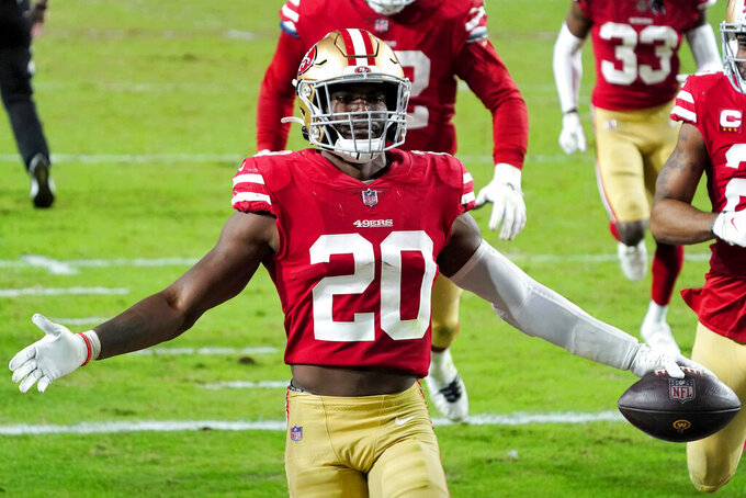 San Francisco 49ers free safety Jimmie Ward (20) celebrates his interception against the Washington Football Team during the second half of an NFL football game, Sunday, Dec. 13, 2020, in Glendale, Ariz. (AP Photo/Rick Scuteri)