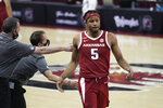 FILE - Arkansas guard Moses Moody (5) is congratulated as he walks to the bench during the second half of an NCAA college basketball game against South Carolina  in Columbia, S.C., in this Tuesday, March 2, 2021, file photo. Moody is The Associated Press Newcomer of the Year in the Southeastern Conference and a member of the All-SEC first team, in voting announced Tuesday, March 9, 2021. (AP Photo/Sean Rayford, File)