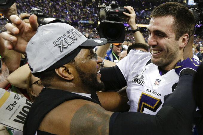 FILE - In this Feb. 3, 2013, file photo, Baltimore Ravens linebacker Ray Lewis, left, and quarterback Joe Flacco celebrate their 34-31 win against the San Francisco 49ers in the NFL Super Bowl XLVII football game, in New Orleans. (AP Photo/Julio Cortez, File)