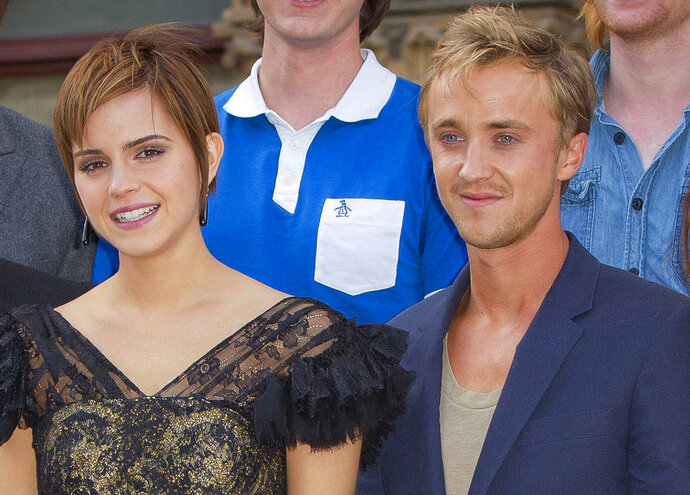 "In this July 6, 2011 file photo, actors, from left,  Emma Watson and Tom Felton pose at St Pancras Renaissance Hotel in central London.  ""Harry Potter"" co-stars Emma Watson and Tom Felton went for a ride on a skateboard. Watson posted a short video on Instagram. Felton cautioned Watson, ""Easy with the waddling. Keep your feet still."" She laughed and said they were. He then said, ""You're dancing around the board like a clown. Hang on tight.""  Watson wrote a post congratulating Fenton on his new Youtube sci-fi series, ""Origin,"" which premieres on Nov. 14, 2018.   (AP Photo/Joel Ryan)"