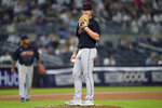 Cleveland Indians starting pitcher Zach Plesac waits to be removed after giving up an RBI single to New York Yankees' Gio Urshela during the seventh inning of a baseball game Friday, Sept. 17, 2021, in New York. (AP Photo/John Minchillo)