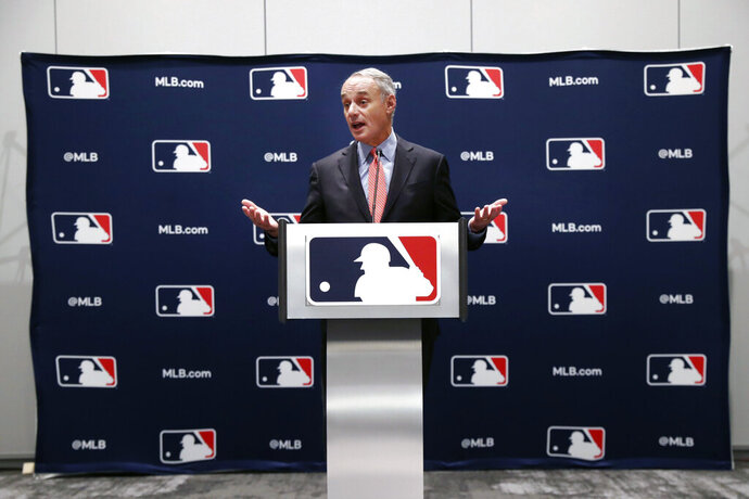 Baseball commissioner Rob Manfred speaks to the media at the owners meeting in Arlington, Texas, Thursday, Nov. 21, 2019. (AP Photo/LM Otero)