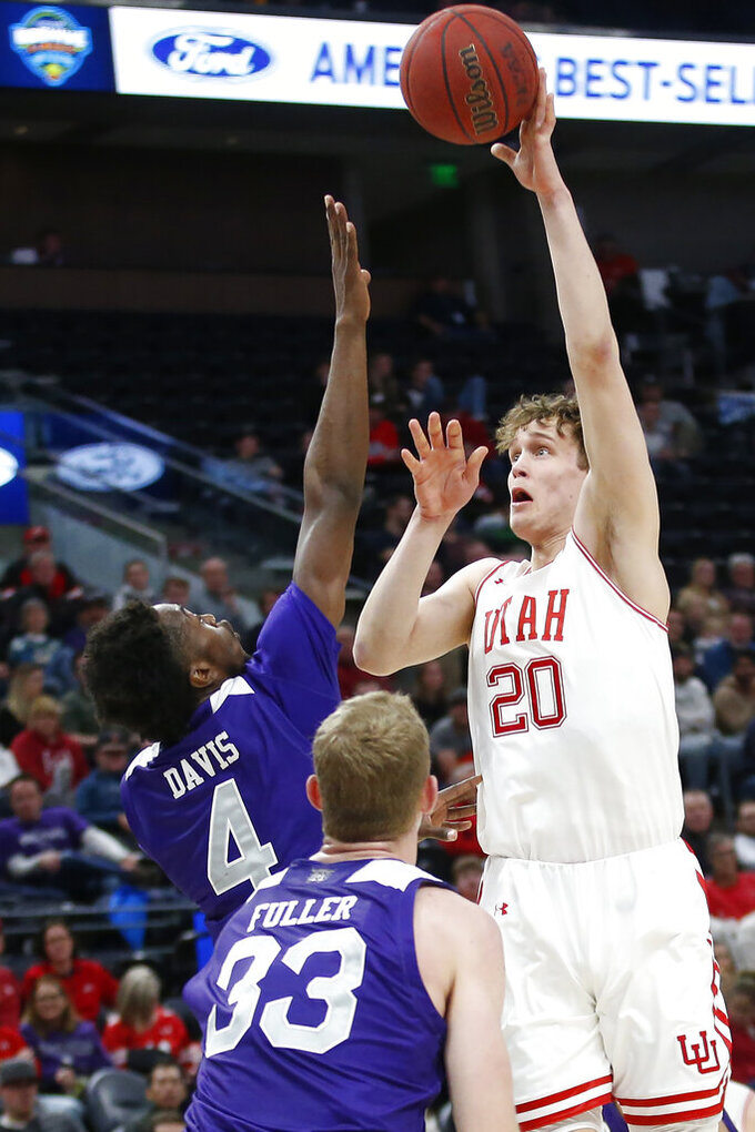 Weber State's Kham Davis (4) and Tim Fuller (33) defend against Utah forward Mikael Jantunen (20) as he shoots in the second half during an NCAA college basketball game Saturday, Dec. 14, 2019, in Salt Lake City. (AP Photo/Rick Bowmer)