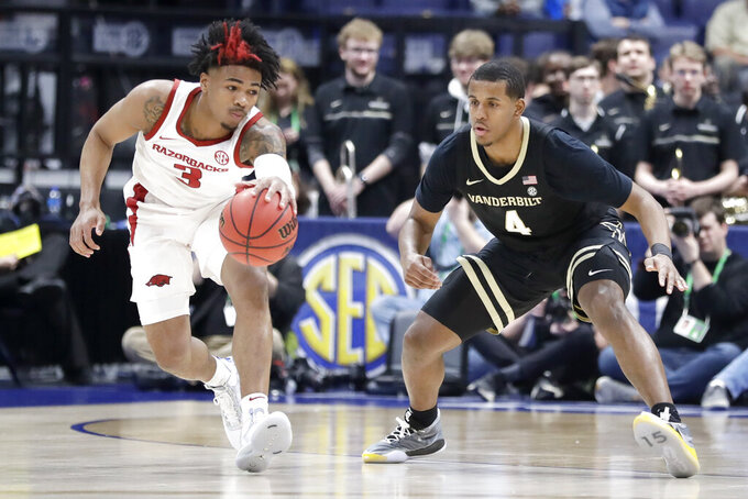 Arkansas guard Desi Sills (3) is defended by Vanderbilt's Jordan Wright (4) in the first half of an NCAA college basketball game in the Southeastern Conference Tournament Wednesday, March 11, 2020, in Nashville, Tenn. (AP Photo/Mark Humphrey)