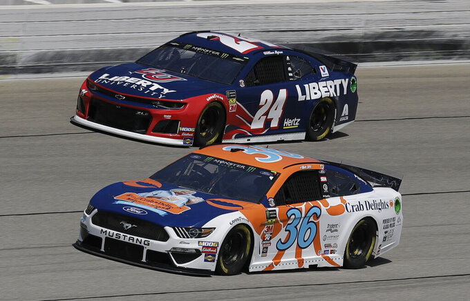 William Byron (24) and Matt Tifft (36) drive during a practice for the NASCAR Sprint Cup Series auto race at Chicagoland Speedway in Joliet, Ill., Saturday, June 29, 2018. (AP Photo/Nam Y. Huh)