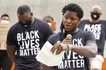 "FILE - In this June 5, 2020, file photo, Jacksonville Jaguars football player Chris Conley addresses the crowd of teammates, staff and families on the steps of the Jacksonville Sheriff's Office headquarters building in Jacksonville, Fla., as they protest against inequality and police brutality. Conley is calling on ""figures who are the face of the league"" to do more to help fight social injustice. The sixth-year pro made it clear Thursday, Aug 27,  he was talking about the NFL's top quarterbacks, the ones who have the most influence in games, in locker rooms and in communities. Think Tom Brady, Drew Brees, Patrick Mahomes, Deshaun Watson, Russell Wilson and Lamar Jackson, for starters. (Bob Self/The Florida Times-Union via AP File)"