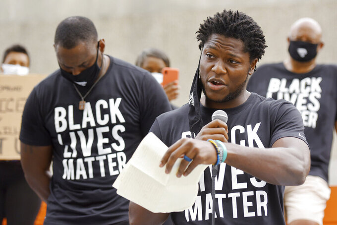 """FILE - In this June 5, 2020, file photo, Jacksonville Jaguars football player Chris Conley addresses the crowd of teammates, staff and families on the steps of the Jacksonville Sheriff's Office headquarters building in Jacksonville, Fla., as they protest against inequality and police brutality. Conley is calling on """"figures who are the face of the league"""" to do more to help fight social injustice. The sixth-year pro made it clear Thursday, Aug 27,  he was talking about the NFL's top quarterbacks, the ones who have the most influence in games, in locker rooms and in communities. Think Tom Brady, Drew Brees, Patrick Mahomes, Deshaun Watson, Russell Wilson and Lamar Jackson, for starters. (Bob Self/The Florida Times-Union via AP File)"""