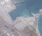 A June 12, 2019, satellite photo from Planet Labs Inc. shows what appears to be barracks at a port at an Emirati military base in Assab, Eritrea. The United Arab Emirates is dismantling parts of a military base it runs in the East African nation of Eritrea after it pulled back from the grinding war in nearby Yemen, satellite photos analyzed by The Associated Press show. (Planet Labs Inc. via AP)