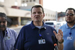 The CEO of Medical Center Hospital in Odessa, Russell Tippin, speaks to reporters outside the hospital in Odessa, Texas, Saturday, Aug. 31, 2019, following a deadly shooting. Several people were dead after a gunman who hijacked a postal service vehicle in West Texas shot more than 20 people, authorities said Saturday. The gunman was killed and a few law enforcement officers were among the injured. (Jacy Lewis/Reporter-Telegram via AP)