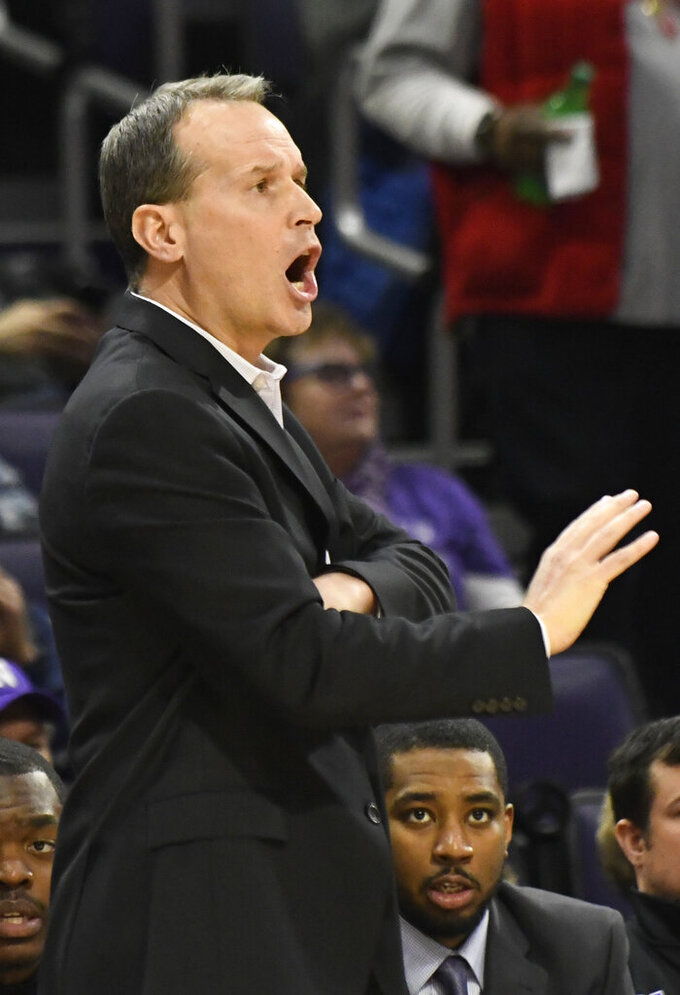 Northwestern head coach Chris Collins gestures to his team during the first half of an NCAA college basketball game Tuesday, Jan. 22, 2019, in Evanston, Ill. (AP Photo/David Banks)