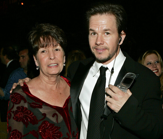 """FILE - In this Sunday, Jan. 16, 2005, file photo, Mark Wahlberg, executive producer of the HBO series """"Entourage,"""" and his mother Alma pose at the HBO party after the 62nd Annual Golden Globe Awards, in Beverly Hills, Calif. Alma Wahlberg, the mother of entertainers Mark and Donnie Wahlberg and a regular on their reality series """"Wahlburgers"""", has died, her sons said on social media Sunday, April 18, 2021. She was 78. """"My angel. Rest in peace,"""" Mark Wahlberg tweeted. (AP Photo/Lisa Rose, File)"""