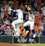 Houston Astros' Tony Kemp (18) and Alex Bregman (2) celebrate after the team's baseball game against the Oakland Athletics on Tuesday, July 10, 2018, in Houston. The Astros won 6-5. (AP Photo/David J. Phillip)