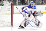 """FILE - In this April 1, 2019, file photo, New York Rangers goaltender Henrik Lundqvist, of Sweden, is shown in action against the New Jersey Devils during the second period of an NHL hockey game, in Newark, N.J. """"The King"""" is 37 yet could be the difference between the New York Rangers missing the playoffs for a third consecutive season and contending ahead of schedule. (AP Photo/Julio Cortez, File)"""