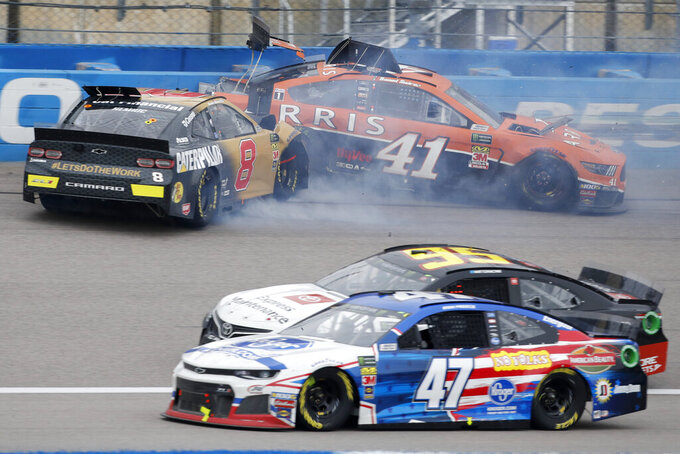 Ryan Preece (47) and Matt DiBenedetto (95) avoid the collision between Daniel Hemric (8) and Daniel Suarez (41) during a NASCAR Cup Series auto race at Kansas Speedway in Kansas City, Kan., Sunday, Oct. 20, 2019. (AP Photo/Colin E. Braley)