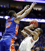 Auburn forward Horace Spencer, right, shoots against Florida center Kevarrius Hayes (13) in the second half of an NCAA college basketball game at the Southeastern Conference tournament Saturday, March 16, 2019, in Nashville, Tenn. Auburn won 65-62. (AP Photo/Mark Humphrey)